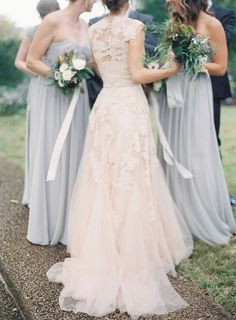 Blush wedding dress with grey bridesmaids dresses.