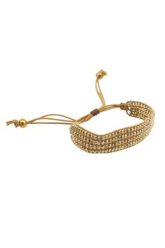 I like the way the casual style of this bracelet mixes with the shiny beads.