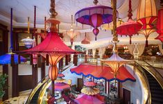 Two bars in one, with colorful umbrellas as the main decoration. Parasol Up is on the main floor of the casino and the perfect meeting spot with comfortable couches surrounded by drapes and the Wynn's elaborate floral displays. Take the escalator downstairs to Parasol Down, a more intimate spot suited for a quiet conversation, a glass of wine, and a view of the outdoor Lake of Dreams and 40ft waterfall.