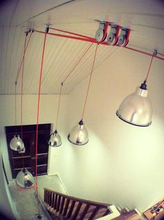 Pulleys, orange power cord and metal lamps