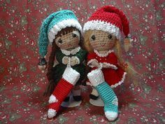 These are simply adorable! This website has many patterns for crochet dolls -- these have adorably long Santa hats and faux-smocked dresses. The pattern even tells you how to make the doll-size Christmas stocking. Check it out!