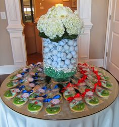 Golf Centerpiece using golf balls, tees, hydrangeas and gerbera daisies. Perfect for a Golf Party or Outing. By Bloom Events, Charlotte NC