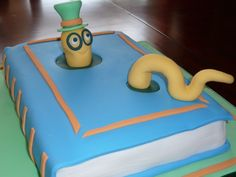 """Back to School Bookworm -   The cake is pineapple flavor with pineapple-lemon butter cream under fondant.   The recipe is from Debbie Brown's """"50 Easy Party Cakes""""."""