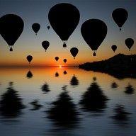 in a hot air ballon at the crack of dawn