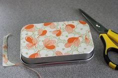I had a few of these cute blank Altiod-like tins laying around and I thought they would be perfect little containers for sewing or knitting ...