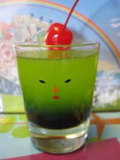The Dashing Prince (Katamari Damacy Shot)  Ingredients: (recipe makes 6 shots) 1 oz Blue Curacao 1/2 oz Grenadine 2 oz Vodka 2 oz Midori Melon Liqueur 2 oz Pineapple juice 1 oz Fresh lemon juice 6 Maraschino cherries with stems