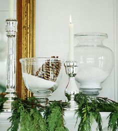 Faux snow drifts in glass containers create a festive, wintery look. More ideas for holiday greenery: http://www.bhg.com/christmas/indoor-decorating/add-warmth-with-holiday-greenery/?socsrc=bhgpin110712greenerymantel#page=5