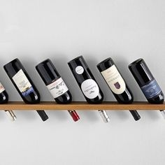 "Great idea for an easy to make at home, hand crafted wine rack! Use any piece of wood, drilling holes to rest the wine! 1.5""- 2.5"" in measure depending on how deep you'd like the bottles to sit. ( cute tip: use something recycled, I love using old doors, frames, or other second use materials for this look! by love_l"