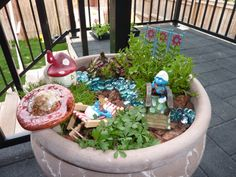 Smurf gardens are for boys!  Fairy gardens are for girls.  If you have a boy, why not put one of these  cute Smurf Gardens together.  Smurf with guitar.  Smurf with medal.
