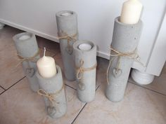DIY Concrete Tea Light Candle Sticks Or could tape several together to make a larger mold - maybe flower shaped? Cement Design, Cement Art, Concrete Crafts, Concrete Art, Concrete Projects, Concrete Candle Holders, Diy Candle Holders, Creation Deco, Candlesticks
