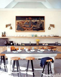 A pool house room that combines kitchen with family hangout space. Design: David Kleinberg