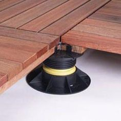 it Adjustable foundation pads for the Bison Ipe wood deck tiles available at Deck Expressions Wood Deck Tiles, Concrete Patio, Wood Pool Deck, Easy Deck, Cool Deck, Raised Deck, Laying Decking, Ipe Wood, House Deck