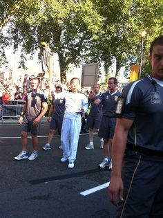 Ban Ki Moon - UN Secretary General - carrying the Olympic torch in London's Parliament Square.