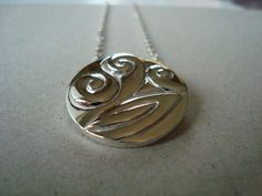 Solid Koru necklace handcrafted in sterling silver by AndisJewelry, $169.00