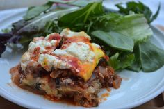 """This grain free lasagna uses zucchini and eggplant as the """"noodles"""". It's then topped off with goat cheese! Yum!"""