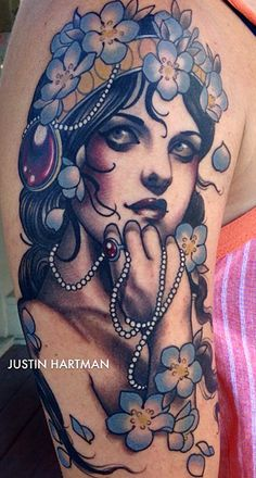 Justin Hartman- gorgeous tattoo. I like the subtle muted colors wiht the black and grey.