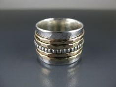 silver spinner ring with five spinners spinner door formandfunktion