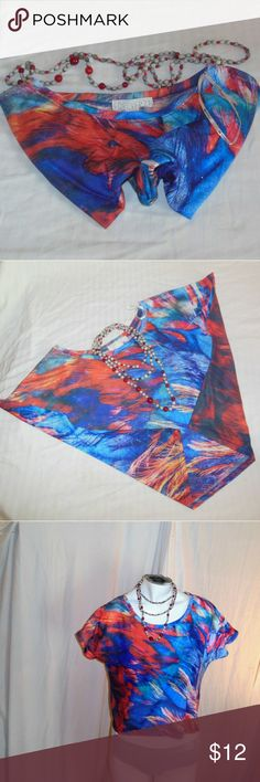 Forever 21 Multicolored Crop Top Size M/M Up for grabs is a multicolored crop top made by Forever 21 in size M/M. In red, sky blue, turquoise, white, blue, and little bits of purple, is top is definitely one to catch your eye. It is a very lightweight material. Please note that any objects photographed with this top are not included. Make sure you shop my closet and add another item along with this one to receive 10% off! Forever 21 Tops Crop Tops