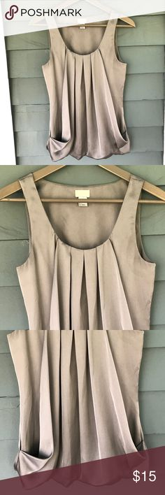 """H&M Gray Satin Top H&M Gray Satin Top. Sleeveless.  Pleat adorned front.  Scoop neckline.  Front folded hand pockets.  Bubble hemline.  Gray polyester satin material.  Pit-to-pit 16-1/2"""".  Length 24"""" (shoulder to hem).  Excellent condition. H&M Tops Tank Tops"""