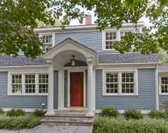 Exciting Concord Exterior Design With Natural Wood Entry Door Decorated With Outdoor Ceiling Lamp Traditional House With Plank Wall