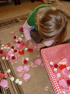 Valentine sensory box -- hearts, rose petals, puffs
