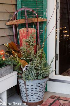 vintage sled and metal bucket for outdoor Christmas decor