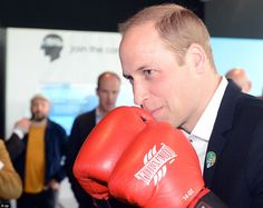 Prince William was the picture of concentration as he prepared to throw a punch ...