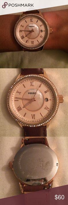 Rose Gold Fossil Watch Beautiful rose gold Fossil watch with brown leather strap. Mother of pearl center with a cream watch face. Great casual watch that will catch someone's eye. Worn 10-12 times. Strap in immaculate condition, minor scratches on case back. Fossil Accessories Watches