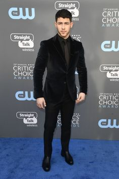 """Nick Jonas from 2018 Critics' Choice Awards Red Carpet Fashion The """"Find You"""" singer continues to prove he's one of the Best Dressed this award season. Marissa Machado helped with grooming while Avo Yermagyan styled this look. Nick Jonas, Celebrity Baby Pictures, Celebrity Babies, Mens Fashion Suits, Mens Suits, Black Suit Men, Smart Casual Menswear, Best Dressed Man, Critics Choice"""