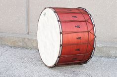 "Chromatic Black Rings Tupan: Here's another idea: pick your colors!  This Tupan features the customer's choice of cotton ring wrap fabric, cradle ropes, vertical ropes, and extra logos. This drum features 16 hand-burnt logos, chromatic black-wrapped rings and ""burgundy with rust"" vertical rope.  16x24; plied maple; satin wax.  To see more pix, and search our entire TreeHouse archive for your favorite specs, visit our photo gallery: http://www.flickr.com/photos/treehousedrums/collections/"