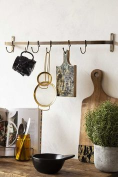 Lifestyle image of the Antique Bronze Finish Hook Rail on a crowded wooden shelf with white wall background Gold Kitchen Utensils, Brass Kitchen, Kitchen Dining, Kitchen Shelves, Quirky Kitchen, Kitchen Ideas, Kitchen Inspiration, Cookbook Holder, Rockett St George