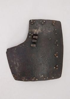 Right breastplate from a brigandine Date: ca. 1450 Culture: Italian Medium: Steel, brass or copper alloy Dimensions: H. 7 3/4 in. (19.7 cm); W. 7 in. (17.8 cm); Wt. 1 lb. 7.8 oz. (674.7 g)