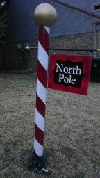 My North Pole made from pvc pipe, red, white and gold spray paint, Black vinyl, curtain rod, wood for sign and a rubber ball for the top.