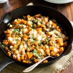 Ground Turkey Sweet Potato Skillet Recipe Main Dishes with extra-virgin olive oil, lean ground turkey, garlic cloves, onions, yellow peppers, sweet potatoes, salt, pepper, chili pepper, shredded mozzarella cheese, green onions