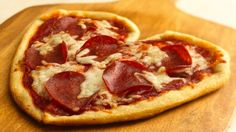 Valentine Pizzas recipe and reviews - You can't get these from a pizza shop! Heart-shaped individual pizzas tell your family they're special. Serve them often!