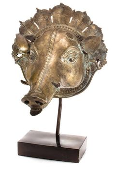 A brass mask of a boar South India, Karnataka, Bhuta culture, early 19th century