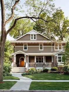 love the brown with the white trim (would have to be black and white for my house), the big front porch with the cool pillars + rock I love!