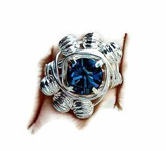 Genuine Swarovski Xilion Silver Plated Setting Crystal 8.5mm in Montana Blue, Wire Wrapped by hand, Made in the USA with silver plated ribbed spacer accents!  Sizes 4-14 and beautiful!  22$
