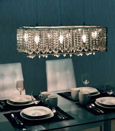 Let the Baarle ceiling lamp's radiant metallic glow shine throughout any space. The lamp has a myriad of crystals, translucent metallic shade and a chrome base. It is UL approved. The height is fully