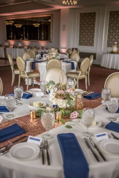 Rose Gold and Navy Wedding Reception Decor with Low Blush Rose Centerpiece with Greenery, Navy Napkins, Blue and White Printed Placecards, and Sequined Table Runners | Tampa Bay Signature Event Rentals | St Pete Wedding Venue The Birchwood | Special Moments Event Planning