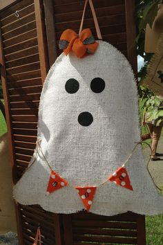 Make your door or home spook-tacular with this Halloween ghost. Kids & adults love ghostie! Its hand-painted burlap sewn together and stuffed with plastic bags for a 3-D effect. Ghostie has a bow and a boo banner. Its approximately 23x22