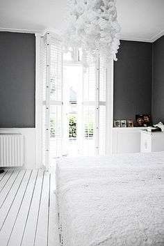 Dark grey wall and white, white, white. For the master bedroom.