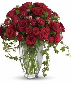 Rose Romantesque Bouquet-A beautiful gift. A heartfelt gesture. A loving tribute. This absolutely stunning red rose arrangement will deliver your care and compassion beautifully. Brilliant red roses and spray roses along with vibrant fern and ivy are perfectly arranged in an exclusive Jewel vase. #SympathyFlowers #AlsFlorist #HollywoodFlorist