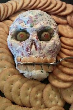 Easy zombie dip!  Cream cheese, shredded cheese, chopped salami/pepperoni/ham, ranch dip mix, garlic powder, parsley flakes, salt/pepper to taste. Add a few dashes of hot sauce if you want. Add olives for eyes and almond slices for teeth. Serve with crackers or veggies.