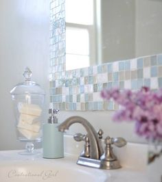 We could use small tile squares as the counter back splash.  Bathroom DIY – Make Your Own Gorgeous Tile Mirror