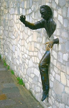 The Man Who Could Walk Through Walls by Karol Franks, via Flickr This sculpture by Jean Marais is in Place Marcel Aymé, in the Montmartre district of Paris.