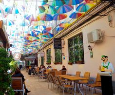 Most people would never think to visit Bucharest for a city break, and they& missing out. Here are some reasons to add Bucharest to your travel hit list. Umbrella Street, Places To Travel, Places To Visit, Romania Travel, City Break, Tenerife, Traveling By Yourself, To Go, Street View