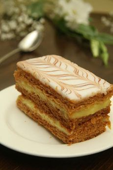 In Canada, mille-feuille is more commonly named 'gâteaux Napoléon,' or 'Napoleon Slice,' (in English Canada) due to the country's long French history. It is sold either with custard, whipped cream, or both, between three layers of puff pastry. Almond paste is the most common flavoured variety. There is a French Canadian way where the mille-feuille is done with graham crackers instead of puff pastry, and where pudding replaces the custard layer.