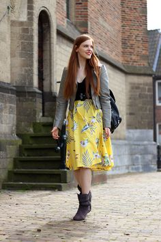 Outfit | A Little Bit of Retro with a Modern Twist | H&M top, belt and grey faux leather jacket, @TopVintage Retro Boutique yellow midi skirt, @Sacha Shoes quilted faux leather backpack, cherry earrings & Café Moda grey slouchy boots | More on www.redsonjafashion.com