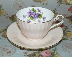 Paragon Violets Pink-Ribbed Tea Cup & Saucer, no dimensions given. $19.99/pr at wildwoodhome on ebay, 3/1/16